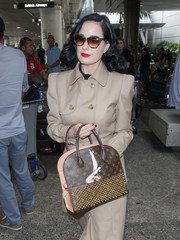 Dita Von Teese showed off her customized Louis Vuitton x Christian Louboutin tote while making her way through LAX.