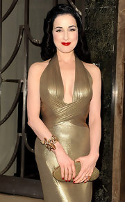 Dita Von Teese added to her luminous look with this glittering gold clutch.