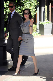 There isn't a moment when Dita Von Teese isn't looking impeccably styled! The burlesque queen donned a retro gray skirt suit with a playful bow. The glam starlet stepped out in spiked Louboutin pumps and her signature red lips.