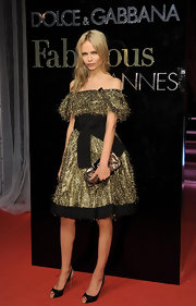 Natasha Poly's off-the-shoulder frock gave the model a touch of sparkle and pizazz on the red carpet.