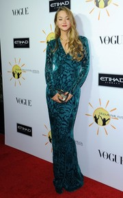 Devon Aoki was all glammed up in a figure-hugging teal evening dress with a subtle velvet burnout.