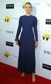Amber Valletta went for subtle sexiness in a backless blue evening dress during the Dream for Future Africa Foundation Gala.