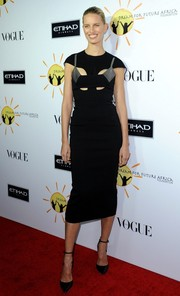 Karolina Kurkova looked slim and stylish at the Dream for Future Africa Foundation Gala in a black Esteban Cortazar dress with cutouts and gray accents on the bodice.