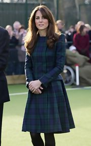 Kate wore this tailored tartan dress to play some field hockey. No denying she looks flawless!