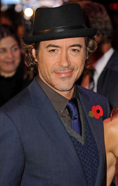 Rpbert Downey Jr. looked handsome in a black fedora with a leather band.