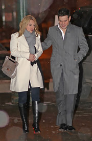 "Hilary looked chic in her cold weather ensemble complete with a pair of knee high black leather ""Babel"" boots."