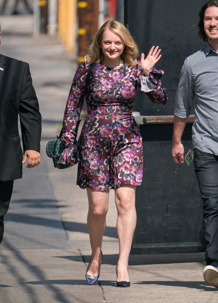 Elisabeth Moss paired her dress with bejeweled blue satin pumps.