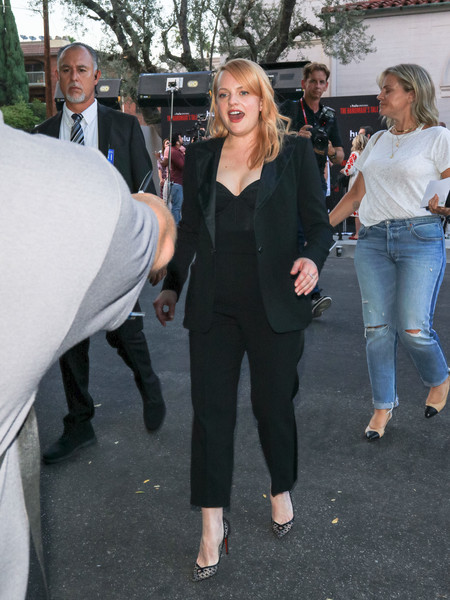 Elisabeth Moss added a girly touch with a pair of black lace pumps by Christian Louboutin.