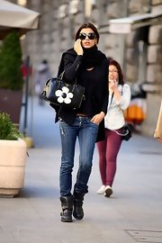 Elisabetta Canalis carried a cool leather tote with a floral twist while out in Milan.