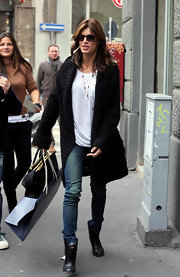 Elisabetta Canalis went shopping in style wearing a cozy long black cardigan and a pair of lived in skinny jeans.