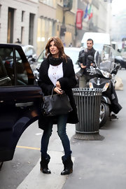 Elisabetta Canalis turned heads in NYC carrying a timeless black leather tote with gold hardware.