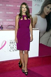 Elizabeth Hurley has never looked better! We loved this hot cranberry cutout dress she wore for Selfridges Breast Cancer Awareness event.