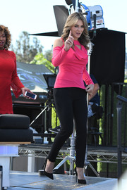 Elizabeth Hurley paired black skinnies with a hot-pink cold-shoulder top for her appearance on 'Extra.'