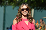Elizabeth Hurley visited 'Extra' wearing her signature face-framing waves.
