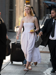 Elle Fanning kept it casual and cute all the way down to her silver Schutz 'No Hate/Love Always' slides.