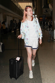 Underneath her jacket, Elle Fanning was casual and comfy in Adidas shorts and a tee.