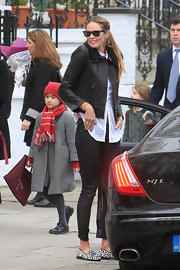 Elle MacPherson dropped her son off at school in a pair of black-and-white animal print loafers.