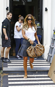 Elle showed off her animal instinct with a leopard print hobo bag while leaving her home.