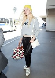 Elle Fanning kept her travel look casual and cool with this gray cropped hoodie.
