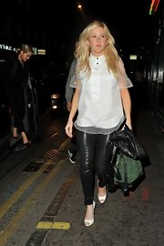 Ellie Goulding opted for a cool white button down top with a sheer overlay for her going out look.