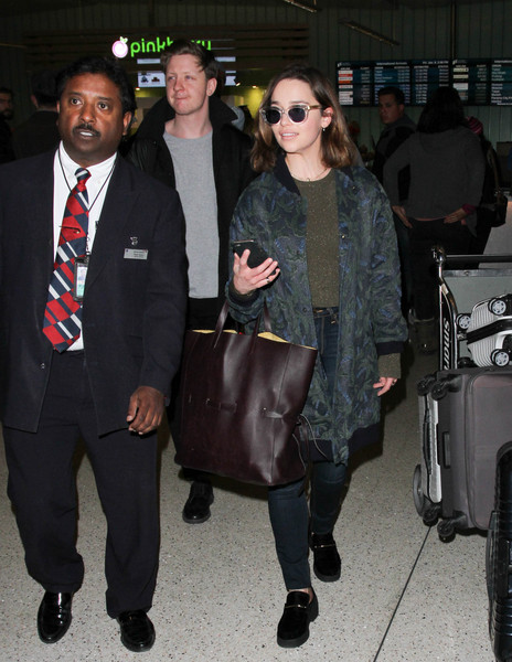 Emilia Clarke was seen at LAX carrying an oversized tote to match her boho outfit.