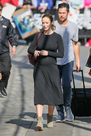 Emily Blunt chose a pair of green suede ankle boots to team with her LBD.