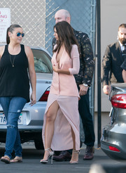 Emily Ratajkowski oozed plenty of sex appeal in a plunging pink La Perla vest layered over a matching high-slit dress while headed to 'Kimmel.'