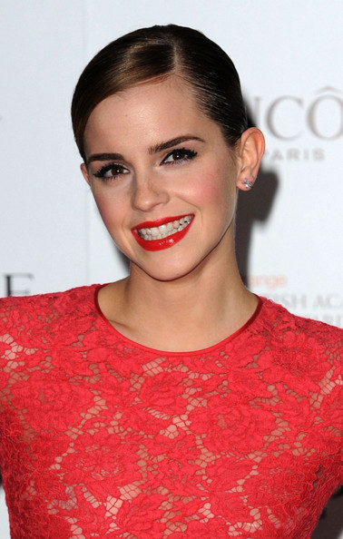 Emma Watson looks stunning in a red lace dress with matching lipstick on the