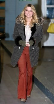 Emma Atkins chose a classic wool coat with fur trim for an outing at the London Studios.