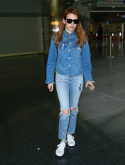 Emma Roberts rocked denim on denim during a flight to JFK. Her jacket is by Mother.