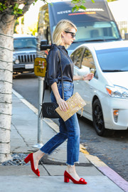 Emma Roberts carried a chic tasseled shoulder bag by Gucci while out shopping.