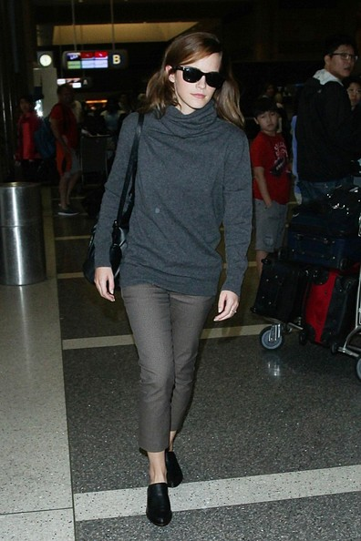 Emma Watson teamed her sweater with taupe capri pants by The Row.