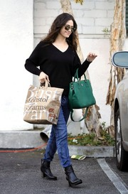 Emmy Rossum was low-key in a black V-neck sweater and jeans while out shopping at Bristol Farms.