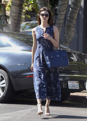 Emmy Rossum matched her frock with a blue Ralph Lauren Ricky tote.