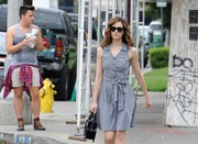 Emmy Rossum was stylishly dressed for warm weather in a sleeveless gingham shirtdress by Aqua.