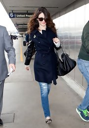 Emmy Rossum complemented her coat with a soft leather hobo bag.