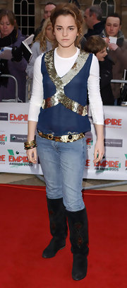 Emma dons knee-high suede black boots with her eclectic ensemble at the Empire Awards.