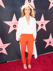 Felicity Huffman paired orange slacks with a white top for Eva Longoria's Hollywood star ceremony.