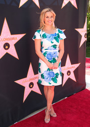 Reese Witherspoon teamed nude Alexandre Birman sandals with a floral frock for Eva Longoria's Hollywood star ceremony.