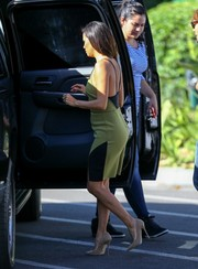 Eva Longoria headed to 'Extra' looking sexy in a backless green and black Bec & Bridge dress.