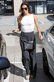 Eva Longoria ran errands in Hollywood carrying a stylish black snakeskin bag.