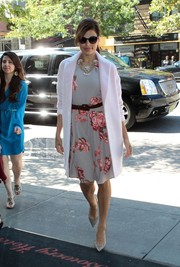 Eva Mendes looked perfectly put together in a sweet floral dress, a wool coat, and a pair of pointy pumps while out and about in New York City.