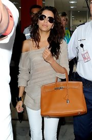 Eva Longoria arrived at Cannes carrying this classic tan leather tote.