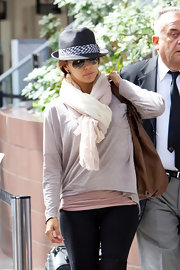 Eva looks super stylish in a blue strap hat and thick scarf.