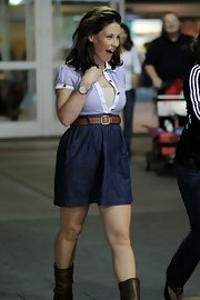 Evangeline Lilly was caught at the airport returning home in a comfortable empire waist belted shirt dress.