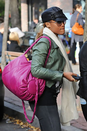 Eve was a bright sight on the streets with this pink duffel bag.