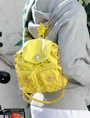 Eliza Doolittle may have dressed like she's ready to workout, but her yellow quilted backpack was anything but casual.