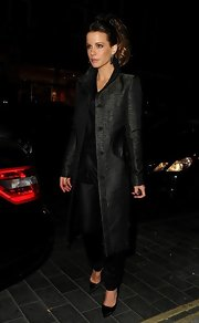 Kate Beckinsale looked evening appropriate with a long tweed coat and black pumps.