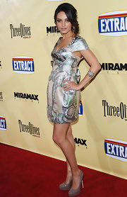 "Mila wore the must-have ""Maniac"" pumps in nude patent leather. The sky-high heels looked amazing with her printed dress."