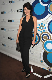 Lisa boldly rocks a black pant suit with pockets.